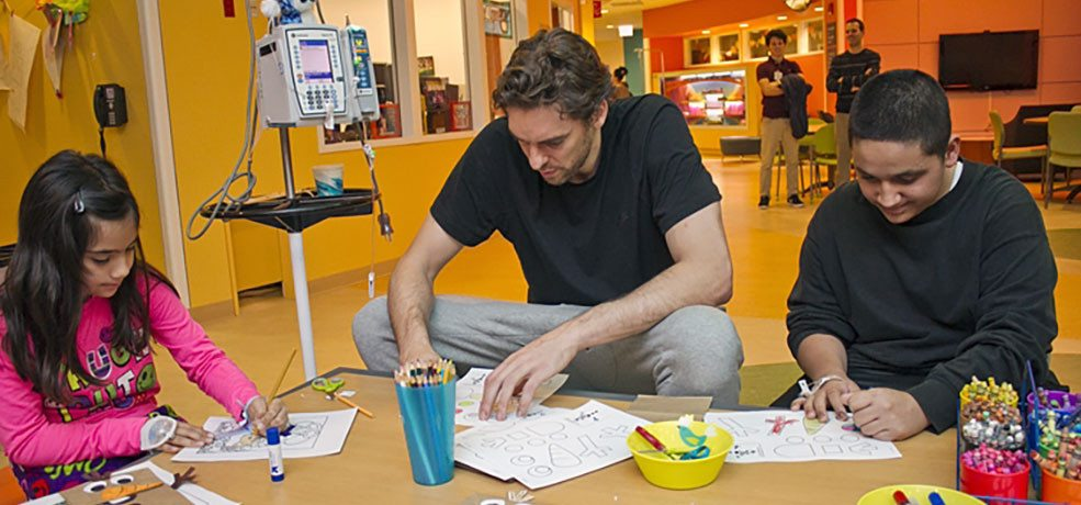 Pau maintains his commitment to children's health with visits to hospitals in Chicago, LA